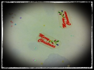 "Part of the ""confetti"" I created to part of the snow globe."